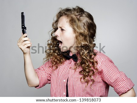 Young pretty woman screaming on the phone - stock photo
