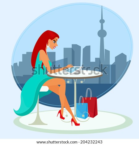Young pretty woman sitting alone in the cafe and using a tablet pc - stock photo