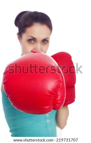Young pretty woman with boxing gloves - stock photo