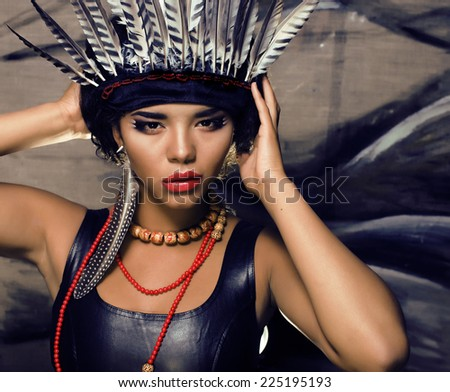 young pretty woman with make up like red indian, halloween teem - stock photo
