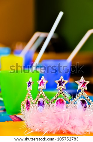 Young princess crown and colourful cups and sippers - children ball equipment - stock photo