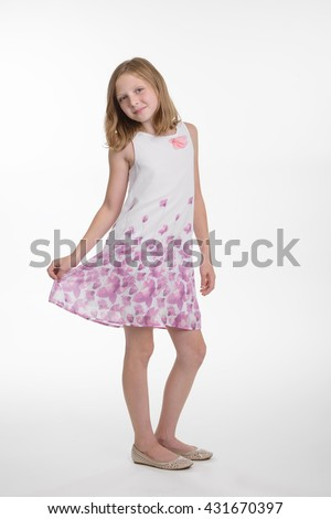 Young princess looks right in the camera with big blue eyes and amazing smile on her face. Full body shot. Isolated. - stock photo
