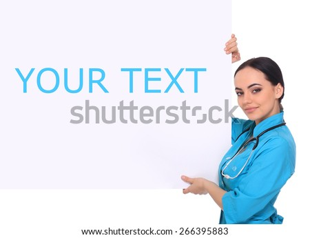 Young - professional and cheerful female doctor standing over big blank billboard isolated on white. - stock photo