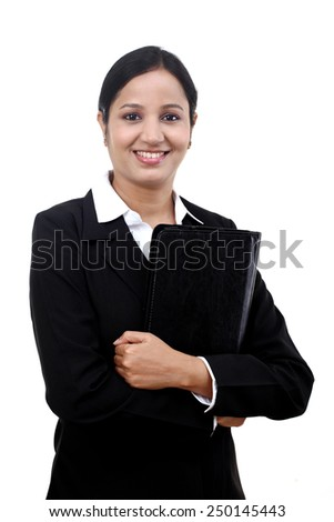 Young professional businesswoman holding a file against White background - stock photo