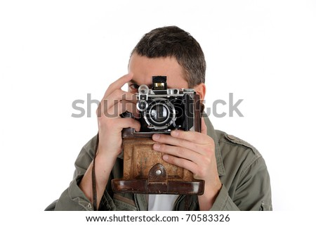 Young professional photographer with old retro film camera. isolated on white background - stock photo
