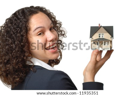 Young professional showing off a home she's selling - stock photo