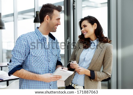 Young professionals having a joyful talk - stock photo