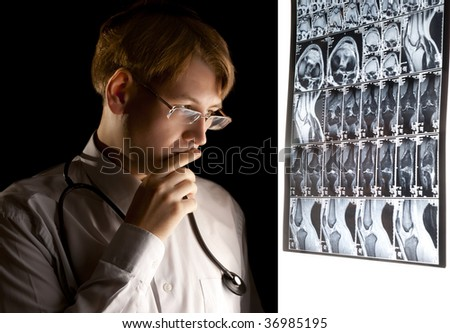Young puzzled doctor thinking about the diagnosis - stock photo