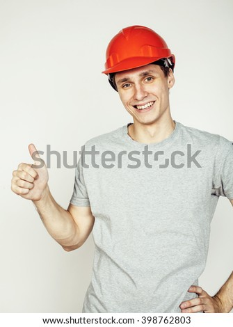 young real hard worker man isolated on white background on ladder smiling posing, business concept - stock photo