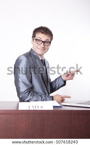 Young receptionist showing direction to exit. - stock photo