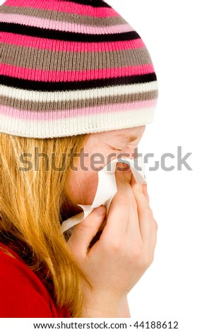 Young red girl blowing her nose - isolated on white - stock photo