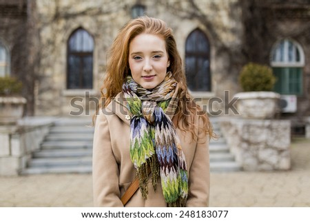 Young red hair university female student - stock photo