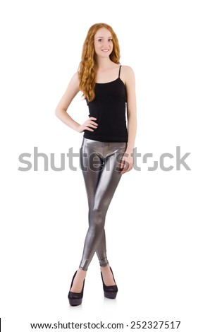 Young redhead girl in tight leggings - stock photo