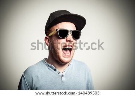 Young redhead is screaming very loud. - stock photo