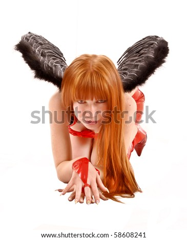 Young redhead woman with black wings isolated on white - stock photo