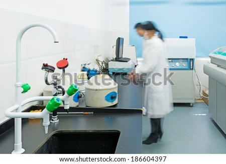 young researcher works in chemistry laboratory  - stock photo