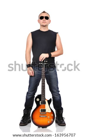 young rocker holding electrical guitar - stock photo