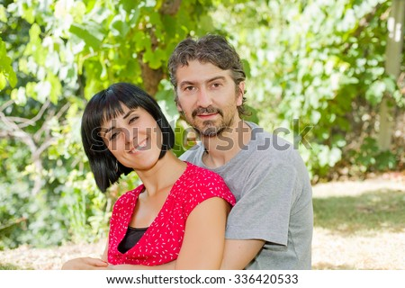 young romantic couple in the park - stock photo