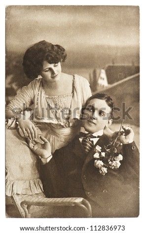 young romantic couple. old sepia picture ca. 1913 - stock photo