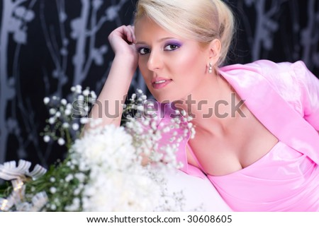 Young romantic woman with flowers portrait. - stock photo
