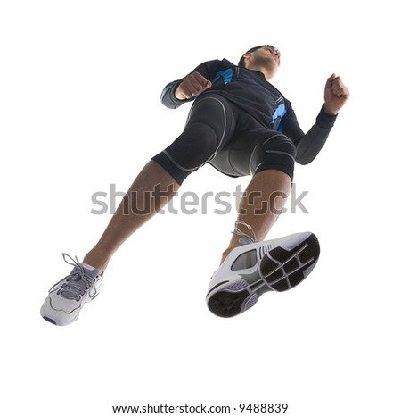 Young running athlete. Wearing tight-fitting uniform. Low angle view - stock photo
