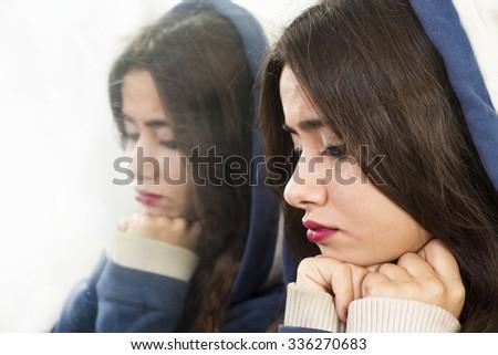 Young sad girl crying - stock photo