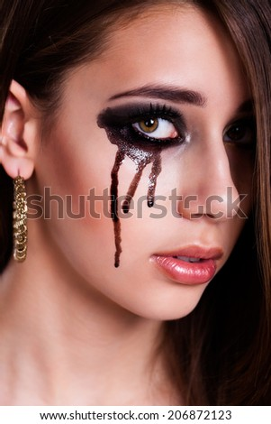 young sad girl with black tears - stock photo