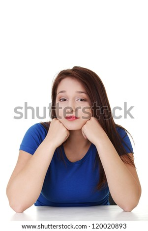 Young sad woman, have big problem or depression, over white background - stock photo