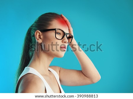 Young sad woman in eyeglasses having headache. Concept of hangover, stress and disease.  - stock photo
