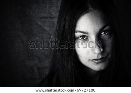 Young sad woman portrait - stock photo