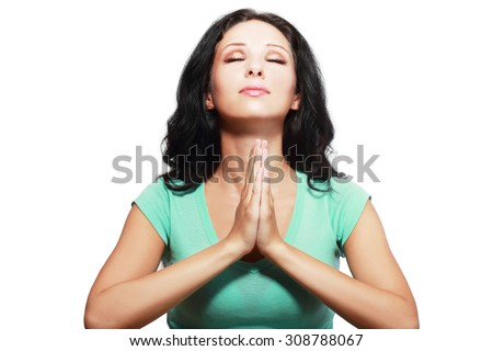 young sad woman praying holding clasp hands together, concept of girl problem, stress, depression, negative emotion - stock photo