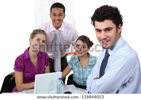 Young sales people having a meeting - stock photo