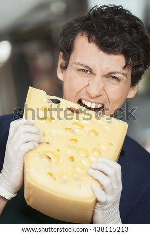 Young Salesman Eating Cheese In Store - stock photo