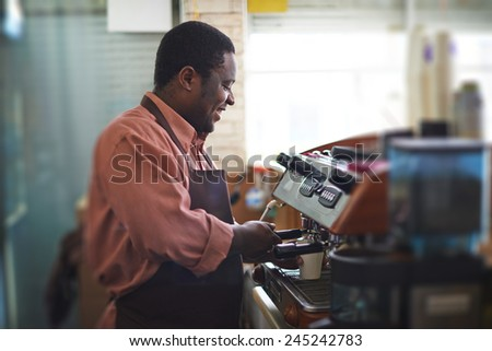 Young salesman working in coffee shop - stock photo