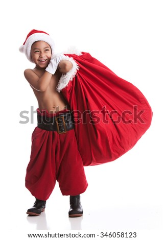 Young Santa.  Adorable mixed race boy pretending to be Santa Claus.  Isolated on white. - stock photo