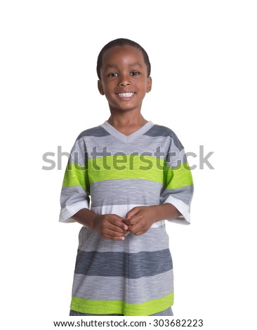 Young school aged boy isolated on white - stock photo
