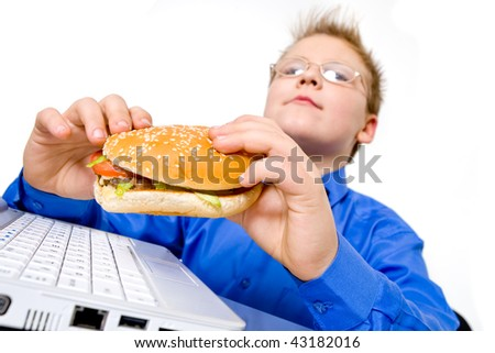 Young school boy with hamburger, isolated on white - stock photo