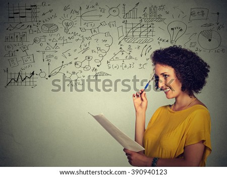 Young school college teacher standing by the chalkboard blackboard during a math science class. Positive face expression. Education concept  - stock photo