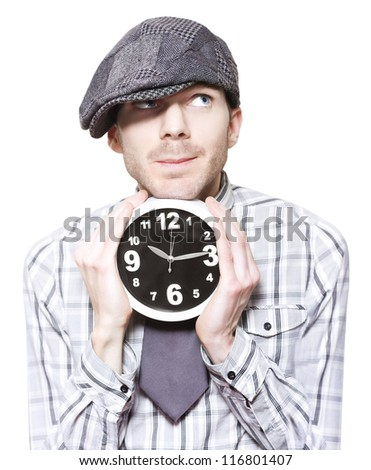 Young School Student Watching Time While Holding Clock In A Back To School Concept Over White - stock photo
