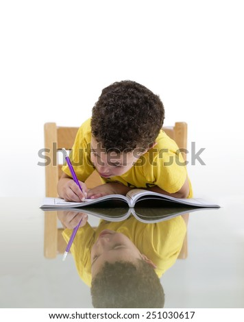Young Schoolboy Studying with Concentration over White Background - stock photo