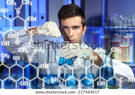 Young scientist working at lab - stock photo