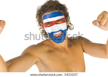 Young screaming and naked Paraguayan sport's fan with painted flag on face and with clenched fist. Front view. Looking at camera, white background - stock photo