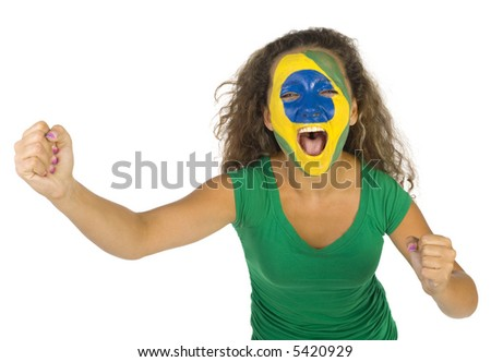 Young screaming Brazilian sport's fan with painted flag on face and with clenched fist. Front view. Looking at camera, white background - stock photo