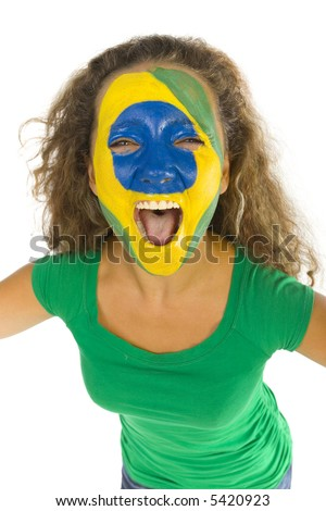 Young screaming Brazilian sport's fan with painted flag on face. Front view. Looking at camera, white background - stock photo
