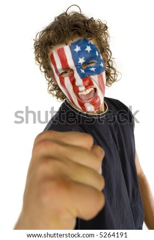 Young screaming fan with painted The USA flag on face. He's looking at camera. Front view - stock photo