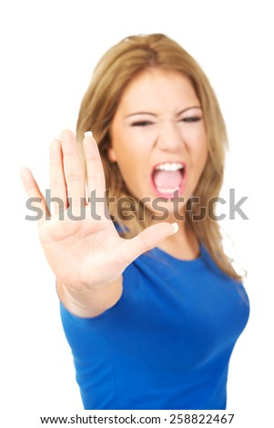 Young screaming woman making stop sign with her hand. - stock photo
