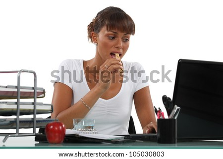 young secretary having a snack - stock photo
