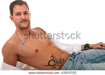 Young seductive caucasian man lying down and showing his beautiful naked chest. Studio shot. White background. - stock photo