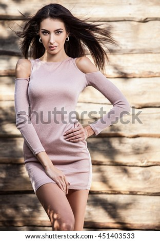 Young sensual & beauty brunette woman pose on grunge wooden background.  - stock photo