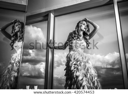 Young sensual & beauty woman in fashionable dress pose indoor. Black-white fashion portrait. - stock photo